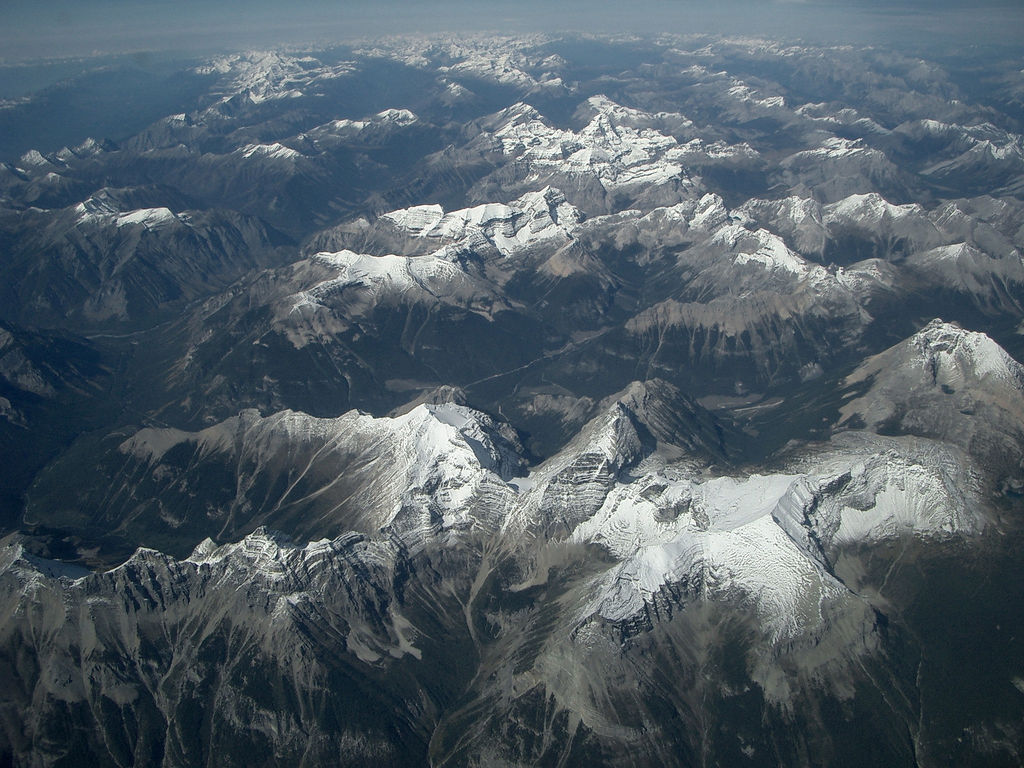 Mountainous landscape with snow tops photographed from the sky